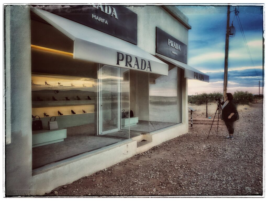 Photographer KC Hulsman shooting at Prada Marfa. Photo courtesy Mary Ann Glass.