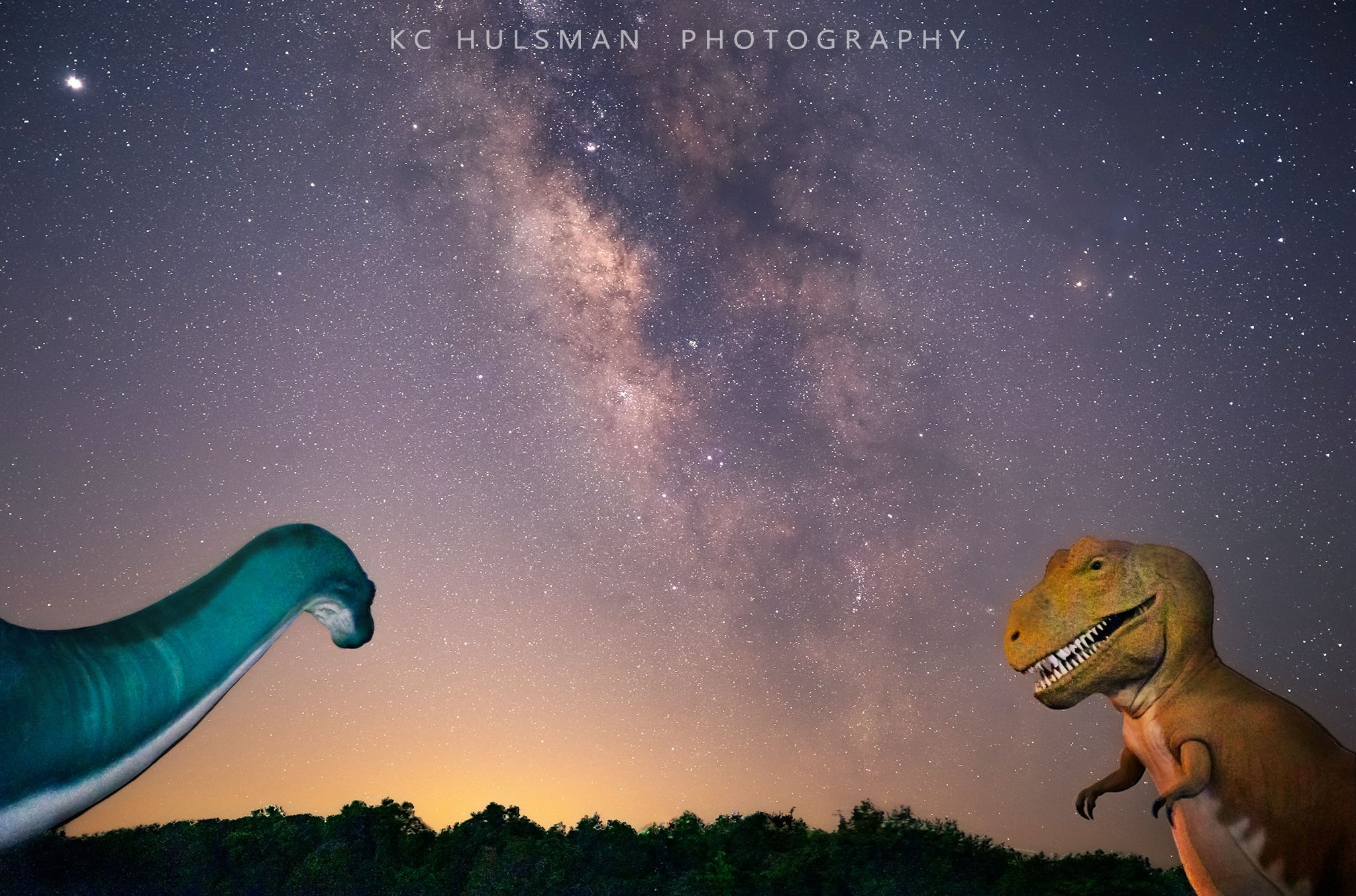 Photograph of the Milky way with Dinosaur Statues by KC Hulsman